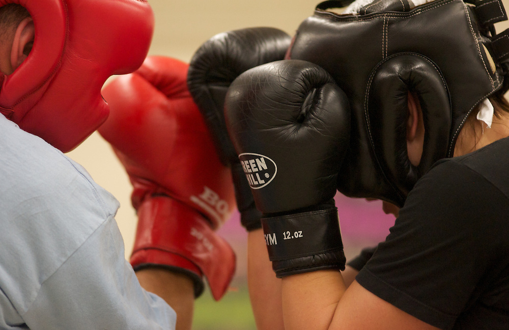 Windsor, Ontario ---10-05-06--- World Welterweight Champion, Mary Spencer, right, spars with a male fighter from her club during a training session at the Windsor Amateur Boxing Club in Windsor, Ontario, May 6, 2010.<br /> GEOFF ROBINS The Globe and Mail
