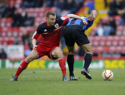 Bristol City's Liam Kelly battles for the ball with Barnsley's Chris O'Grady - Photo mandatory by-line: Joe Meredith/JMP - Tel: Mobile: 07966 386802 23/02/2013 - SPORT - FOOTBALL - Ashton Gate - Bristol -  Bristol City V Barnsley - Npower Championship