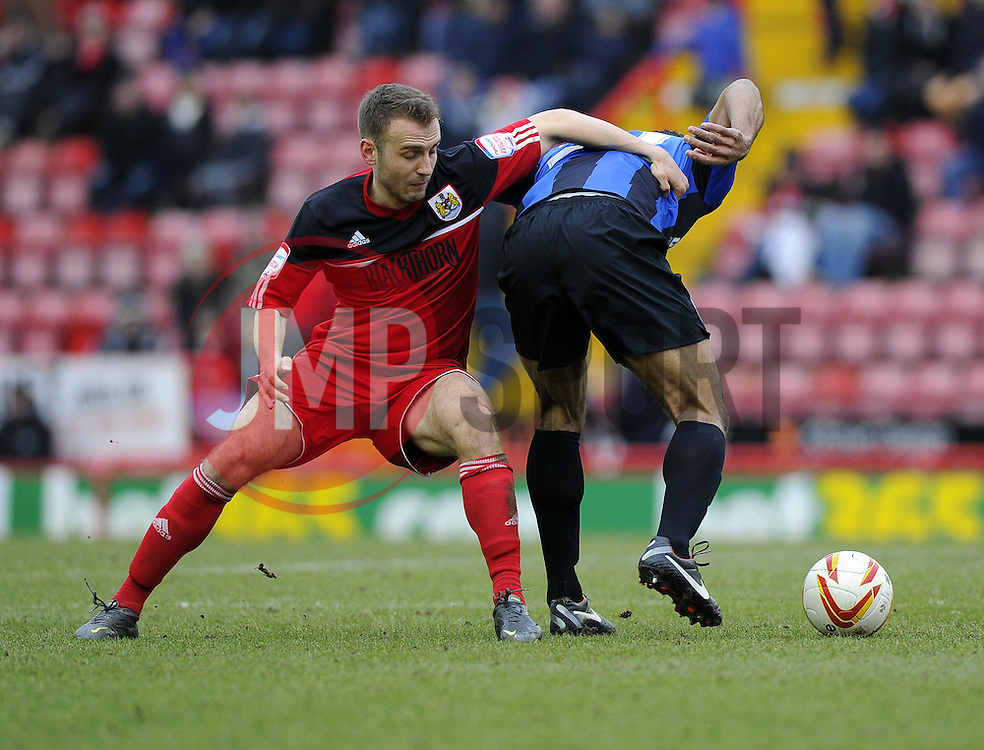 Bristol City's Liam Kelly battles for the ball with Barnsley's Chris O'Grady - Photo mandatory by-line: Joe Meredith/JMP - Tel: Mobile: 07966 386802 23/02/2013 - SPORT - FOOTBALL - Ashton Gate - Bristol -  Bristol City V Barnsley - Npower Championship