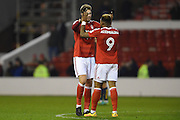 Nottingham Forest forward Nicklas Bendtner (14) and Nottingham Forest forward Britt Assombalonga (9) celebrate after winning 1-0 during the EFL Sky Bet Championship match between Nottingham Forest and Bristol City at the City Ground, Nottingham, England on 21 January 2017. Photo by Jon Hobley.