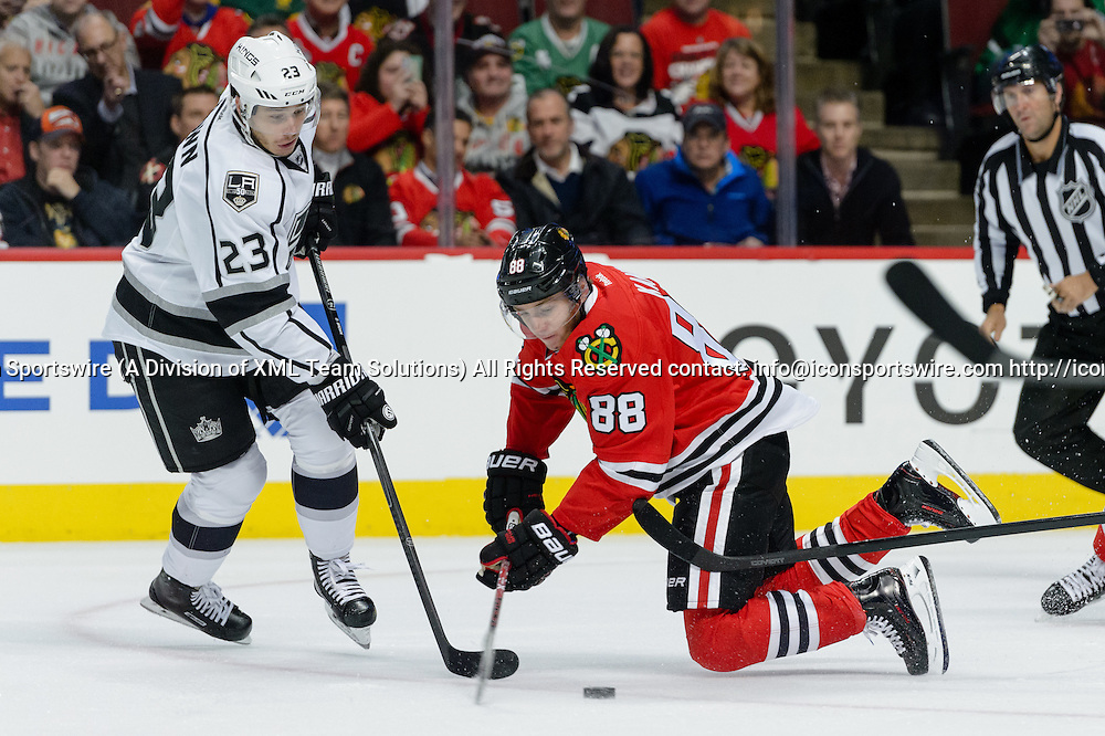 CHICAGO, IL - OCTOBER 30: Chicago Blackhawks Right Wing Patrick Kane (88) is tripped by Los Angeles Kings Right Wing Dustin Brown (23) in the 1st period during an NHL hockey game between the Los Angeles Kings and the Chicago Blackhawks on October 30, 2016, at the United Center in Chicago, IL. (Photo By Daniel Bartel/Icon Sportswire)
