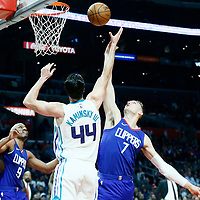 31 December 2017: LA Clippers forward Sam Dekker (7) vies for the rebound with Charlotte Hornets forward Frank Kaminsky (44) during the LA Clippers 106-98 victory over the Charlotte Hornets, at the Staples Center, Los Angeles, California, USA.