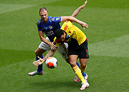 Jonny Evans of Leicester City and Troy Deeney of Watford  during the Premier League match at Vicarage Road, Watford. Picture date: 20th June 2020. Picture credit should read: Darren Staples/Sportimage