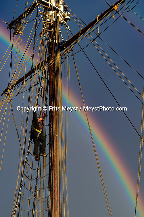 Iceland, April 2019. A stunning rainbow marks the sky above Shooner Opal in the port of Reykjavik. Scientists, storytellers and industrial designers work together during the Ocean Missions Iceland scientific sailing expedition aboard Schooner Opal.  The organisation wants to inspire people to take direct action towards ocean conservation, by combining science and education with exploration and adventure. Photo by Frits Meyst / Meystphoto.com