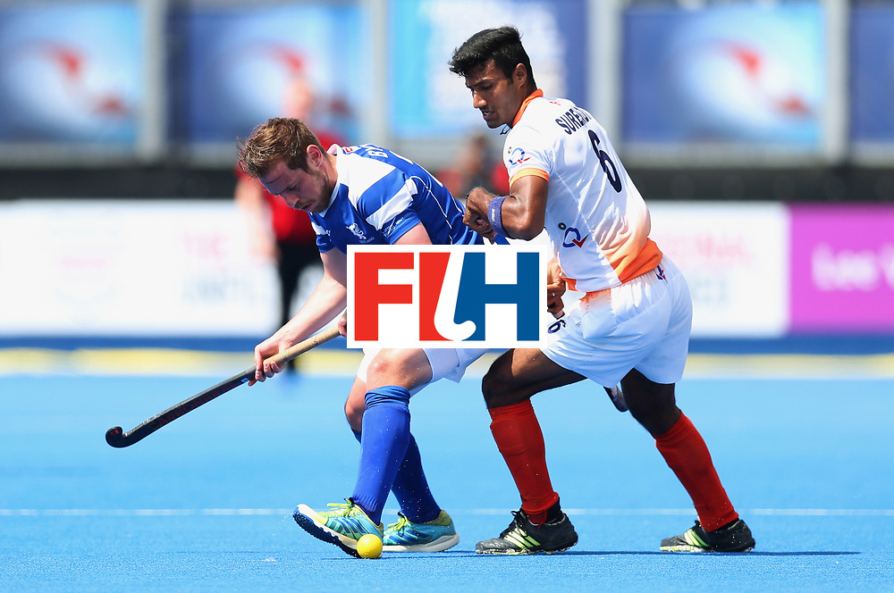 LONDON, ENGLAND - JUNE 15:  Gavin Byers of Scotland shields the ball from Surender Kumar of India during the Pool B match between India and Scotland on day one of Hero Hockey World League Semi-Final at Lee Valley Hockey and Tennis Centreo n June 15, 2017 in London, England.  (Photo by Alex Morton/Getty Images)