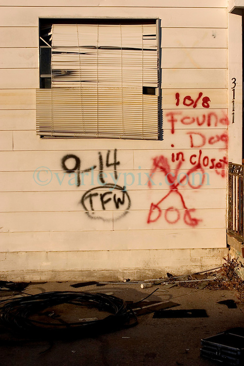 21December 05. New Orleans, Louisiana. Post Katrina aftermath.<br />  Rescue workers graffiti lingers on the walls of the devastated 9th Ward long after the devastating flood from Hurricane Katrina subsided. <br /> Photo; ©Charlie Varley/varleypix.com