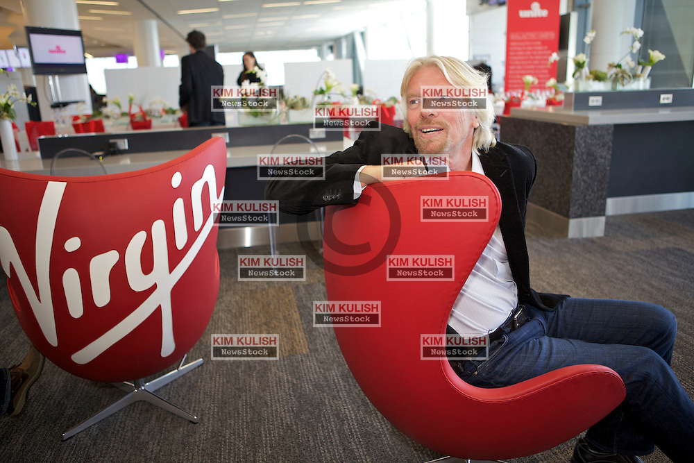 Virgin Group Founder Sir Richard Branson relaxes near the Virgin America gates in the new Terminal 2 at San Francisco International Airport.  The 640,000- square-foot Terminal is expected to be the first LEED Gold-certified terminal in the U.S.