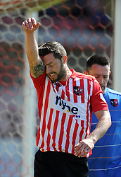 Dejection for Exeter City's Jamie McAllister as he picks up an early injury.  - Photo mandatory by-line: Harry Trump/JMP - Mobile: 07966 386802 - 06/04/15 - SPORT - FOOTBALL - Sky Bet League Two - Exeter City v Newport County - St James Park, Exeter, England.