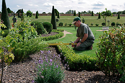 UK ENGLAND SURREY HAMPTON COURT PALACE 19JUL04 - A landscape gardener trims a miniature hedge at the Privvy Garden at Hampton Court Palace. The Palace and its famous royal gardens were founded by King Henry VIII in the sixteenth century and were developed through the centuries by subsequent sovereigns, determined to have the most fashionable and elegant gardens of their era. 2004 is the Year of the Garden at Hampton Court Palace and it is celebrated by a series of special events like the Tudor-costumed garden tours.....jre/Photo by Jiri Rezac ....© Jiri Rezac 2004....Contact: +44 (0) 7050 110 417..Mobile:  +44 (0) 7801 337 683..Office:  +44 (0) 20 8968 9635....Email:   jiri@jirirezac.com..Web:    www.jirirezac.com....© All images Jiri Rezac 2004 - All rights reserved.