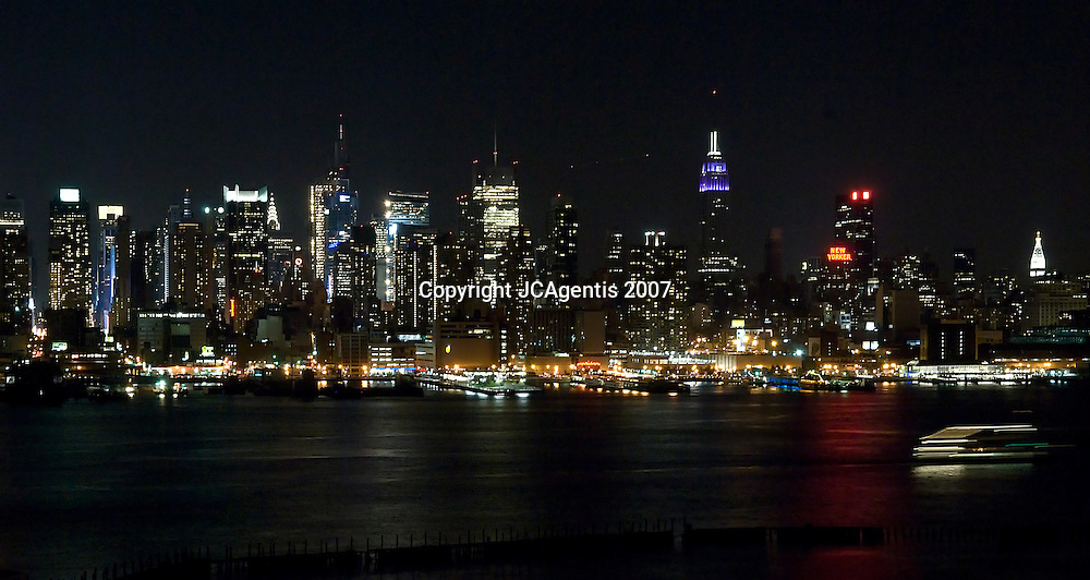 New York City Skyline at Night with boat speeding by, 10/20/2007