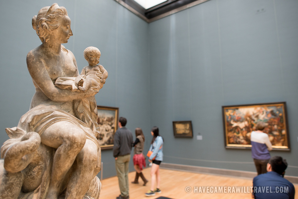 An exhibit room with paintings and sculptures at the Royal Museums of Fine Arts in Belgium (in French, Musées royaux des Beaux-Arts de Belgique), one of the most famous museums in Belgium. The complex consists of several museums, including Ancient Art Museum (XV - XVII century), the Modern Art Museum (XIX  XX century), the Wiertz Museum, the Meunier Museum and the Museé Magritte Museum.