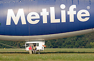 Montgomery, NY  - The ground crew prepare the Met Life blimp Snoopy Two fortake off from Orange County Airport on July 26, 2008.