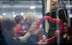 14.09.2015, Hauptbahnhof Salzburg, AUT, Fluechtlinge am Hauptbahnhof Salzburg auf ihrer Reise nach Deutschland, im Bild Flüchtlinge im Zug nach Muenchen // Migrants in the Train to Munich. Thousands of refugees fleeing violence and persecution in their own countries continue to make their way toward the EU, Main Train Station, Salzburg, Austria on 2015/09/14. EXPA Pictures © 2015, PhotoCredit: EXPA/ JFK