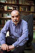 Moroccan writer Tahar Ben Jalloun in his Paris office.<br /> Paris, France. June 1998.