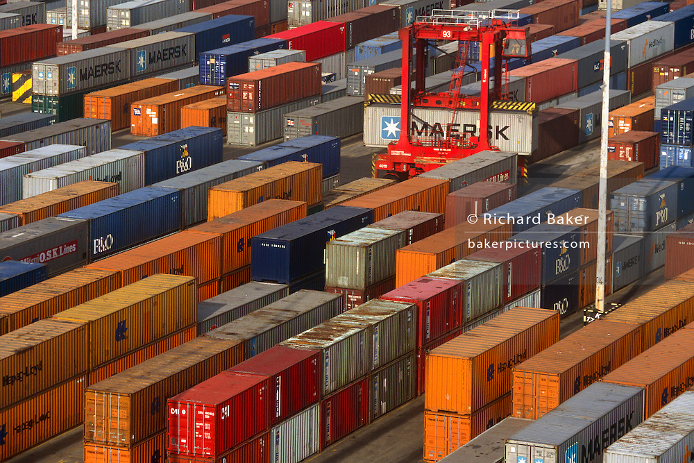 Aerial view of shipping containers stacked and awaiting shipment to other continents and cities with global merchandise