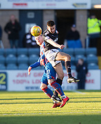20th January 2018, Dens Park, Dundee, Scotland; Scottish Cup fourth round, Dundee versus Inverness Caledonian Thistle; Dundee's Cammy Kerr clears from Inverness Caledonian Thistle's Aaron Doran