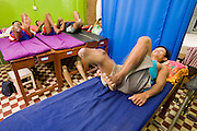 27 JUNE 2006 - SIEM REAP, CAMBODIA: ROS RON, 33, undergoes physical therapy at the Handicap International facility in Siem Reap, Cambodia. Handicap International helps Cambodians maimed by mines and unexploded ordinance as well as traffic accidents and disease adjust to a life without limbs. Cambodians are still wrestling with the legacy of the war in Vietnam and subsequent civil wars. At one time it was the most heavily mined country in the world and a vast swath of Cambodia, along the Thai-Cambodian border, is still mined. In 2004, more than 800 people were killed by mines and unexploded ordinance still found in the countryside.  Photo by Jack Kurtz