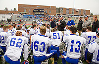 Head Coach Jon Francis speaks to his team immediately following their loss to Newport at the State Championship game held at UNH on Sunday.  (Karen Bobotas/for the Laconia Daily Sun)