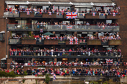 © Licensed to London News Pictures. 03/06/2012. LONDON, UK. Crowd lining the banks of the Thames to watch the flotilla of one thousand ships go past. The Royal Jubilee celebrations. Great Britain is celebrating the 60th  anniversary of the countries Monarch HRH Queen Elizabeth II accession to the throne this weekend Photo credit : Cliff Hide/ LNP
