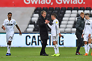 Swansea City manager Graham Potter congratulates Connor Roberts (23) of Swansea City at full time after his team won 2-0 during the EFL Sky Bet Championship match between Swansea City and Reading at the Liberty Stadium, Swansea, Wales on 27 October 2018.