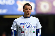 John Terry of Chelsea wearing a ' Building Bridges ' campaign t-shirt as he warms up before the Barclays Premier League match at Stamford Bridge, London<br /> Picture by David Horn/Focus Images Ltd +44 7545 970036<br /> 22/02/2014