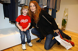 Model ANGELA DUNN and her son MAXIMUS RADCLIFF at the launch party for the Comptoir des Cotonniers boutique, 235 Westbourne Grove, London W11 on 25th October 2006.<br /><br />NON EXCLUSIVE - WORLD RIGHTS