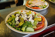 A greek salad sits in the kitchen window waiting delivery at Mil's Diner in Milpitas, California, on September 12, 2014. (Stan Olszewski/SOSKIphoto)