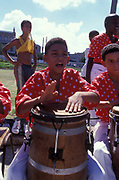 Boy banging on a drum, Brazil, 2000's