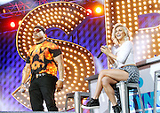 LL Cool J and Julianne Hough appear during the Lip Sync Battle Live at SummerStage in Rumsey Playfield Central Park in New York City, New York on July 13, 2015.
