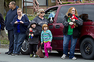 Middletown, New York - People watch children and adults march in the 60th annual Middletown Little League parade on April 14, 2013.