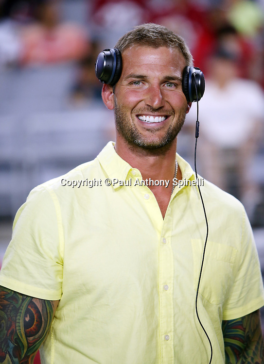 Former San Diego Chargers center Nick Hardwick smiles as he works as a member of the media on the sideline during the San Diego Chargers 2015 NFL preseason football game against the Arizona Cardinals on Saturday, Aug. 22, 2015 in Glendale, Ariz. The Chargers won the game 22-19. (©Paul Anthony Spinelli)
