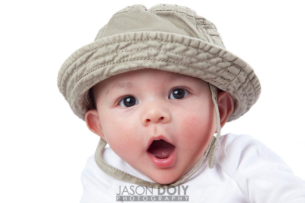 Baby in an explorer hat.