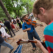 June 4, 2014 - New York, NY : <br /> Sam Harmet, on mandolin (foreground right), and Alex Kramer, on fiddle (center), entertain people who are waiting in line to see Janelle Monáe kick off Celebrate Brooklyn!'s annual concert series in Prospect Park on Wednesday night.<br /> CREDIT: Karsten Moran for The New York Times