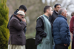 © Licensed to London News Pictures . 03/03/2016 . Manchester , UK . Mourners watch as Shahzaib Hussain is buried at Ashton Hurst Cemetary . Shahzaib was killed by a hit and run driver outside the mosque , on Monday 29th February 2016 . Photo credit : Joel Goodman/LNP