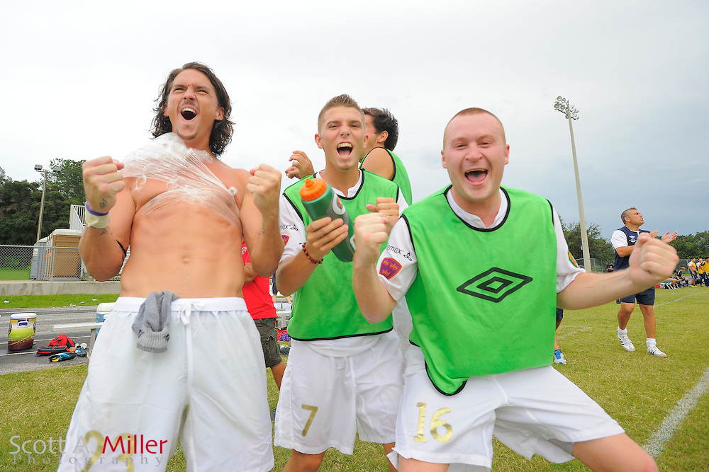Orlando City forward Drew Helm (23), midfielder Nicolas Russo (7) and midfielder Sam Fairhurst (16) celebrate their 4-2 win over the Austin Aztex in PDL Southern Conference Championships final at Trinity Catholic High Schooll on July 22, 2012 in Ocala, Florida. ..©2012 Scott A. Miller