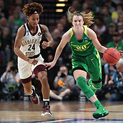 March 31, 2019; Portland, OR, USA; Oregon Ducks guard Sabrina Ionescu (20) pushes the ball up-court against Mississippi State Bulldogs guard Jordan Danberry (24) in the second half of Elite Eight of the NCAA Women's Tournament at Moda Center.<br /> Photo by Jaime Valdez
