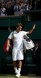 LONDON, ENGLAND - Wednesday, June 30, 2010: Roger Federer (SUI) looks dejected as he walks off Centre Court following his Gentlemen's Singles Quarter-Final defeat on day nine of the Wimbledon Lawn Tennis Championships at the All England Lawn Tennis and Croquet Club. (Pic by David Rawcliffe/Propaganda)