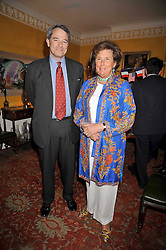 CHARLES GLASS and LADY AMABEL LINDSAY at a party to celebrate the publication of Charles Glass's new book 'Americans in Paris' held at 12 Lansdowne Road, London W1 on 25th March 2009.