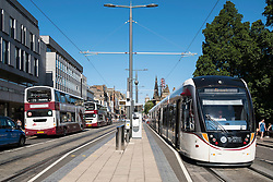 Modern tram at stop on Princes Street in Edinburgh Scotland united Kingdom