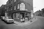 Nurse Coming out of Corner Shop, Lambeth, London, UK, 1980s