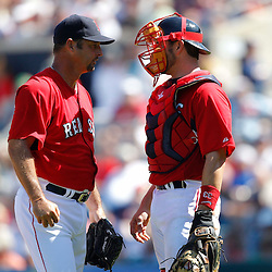 February 28, 2011; Fort Myers, FL, USA; Boston Red Sox starting pitcher Tim Wakefield (49) and catcher Jason Varitek (33) talk on the mound during a spring training exhibition game against the Minnesota Twins at City of Palms Park.  Mandatory Credit: Derick E. Hingle