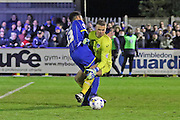 Lyle Taylor forward for AFC Wimbledon (33) in action during the Sky Bet League 2 match between AFC Wimbledon and Portsmouth at the Cherry Red Records Stadium, Kingston, England on 26 April 2016. Photo by Stuart Butcher.