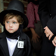 Koen Thomas waits to participate in the Abraham Lincoln look-alike contest at the Shriver House Museum in Gettysburg, PA, during the Sesquicentennial Anniversary of the Battle of Gettysburg on Wednesday, July 3, 2013.  John Boal Photography