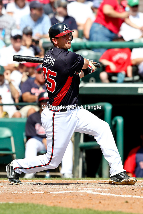 March 16, 2011; Lake Buena Vista, FL, USA; Atlanta Braves first baseman Ed Lucas (75) during a spring training exhibition game against the Boston Red Sox at the Disney Wide World of Sports complex.  Mandatory Credit: Derick E. Hingle