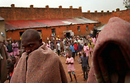 The prison in Kigali, Rwanda, is packed with 6,152 inmates even though is was built in 1930 with a capacity of 2,ooo. In the prison yard inmates stand wrapped in a wool blankets.   The inmates, men, women, and children,  are accused of taking part in last year's ethnic massacres in wich nearly 1 million Rwandans lost their lives. The new government has been unable to rebuild the justice system so the inmates have not been charged or tried in a court. Berkins (6 of 7)