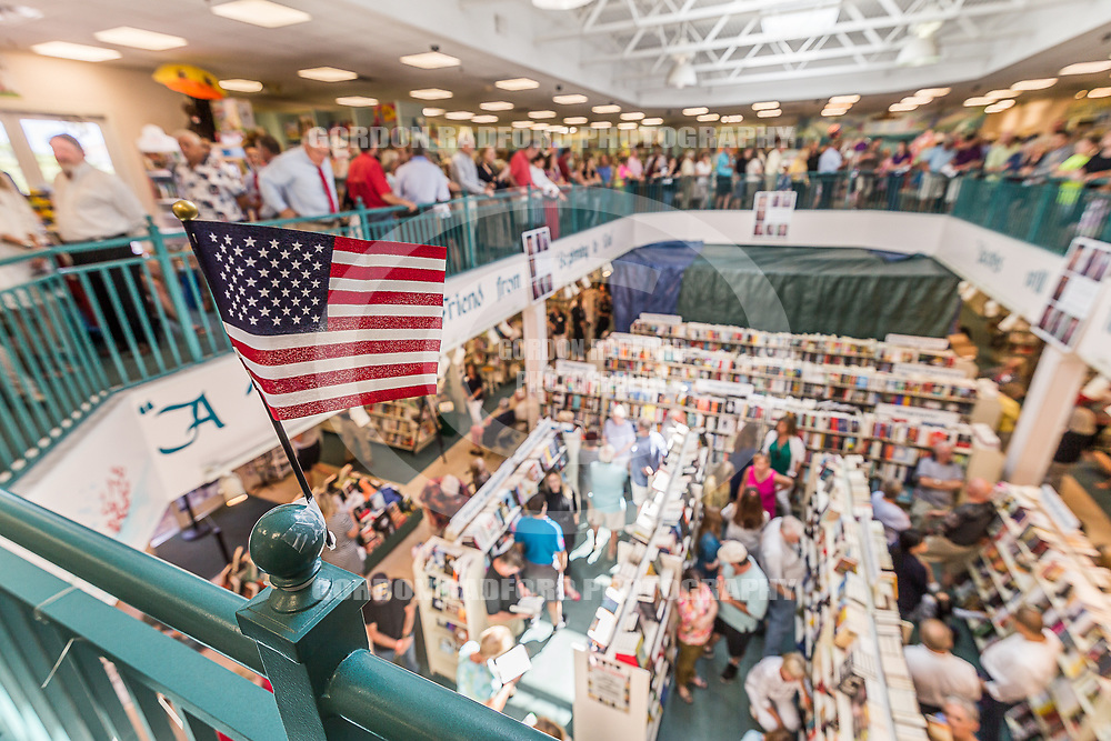"""Customers wait patiently to meet President George W. Bush and to receive a signed copy of his book  """"Portraits of Courage"""" at the Vero Beach Book Center on 4/26/2017."""