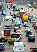 &copy; Licensed to London News Pictures. 14/11/2014. Leatherhead, UK Tailbacks stretched for over twenty miles. M25 section in Surrey collapses following roadworks<br /> M25. The pothole appeared on the M25 in the early hours of 14th November 2014. Three lanes of the M25 in Surrey have been closed after a section collapsed and left a large pothole, following overnight roadworks. Surrey Police said many vehicles had been left with damaged tyres after the road surface near Leatherhead fell in during heavy rain at about 05:30 GMT.. Photo credit : Stephen Simpson/LNP