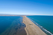 Playa del Trabucador, or El Trabucador beach, a long spit of land near Poble Nou, in the Ebro Delta, aerial view, Tarragona, Catalonia, Spain. The Ebro Delta is the large delta area of the Ebro river, creating a huge wetland area used for agriculture and with protected areas for wildlife, including the Ebro Delta Natural Park. The area has a variety of different ecosystems including lagoons, sand dunes, salt marsh and rice fields which cover around 15000 hectares. Picture by Manuel Cohen