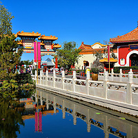 Footbridge Over Pond in China at Epcot in Orlando, Florida <br /> This footbridge over a pond leads to the main attractions at the China Pavilion.  Its style is characteristic of the carved, marble walkways and platforms gracing many of China's famous temples. This promenade resembles those in the Forbidden City and Beihai Park, both in Beijing. In the background is the Nine Dragons Restaurant.