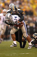 Kansas State running back Leon Patton (14) is brought down by a Missouri defender after picking up a first down at Faurot Field in Columbia, Missouri, October 21, 2006.  The Tigers beat the Wildcats 41-21.<br />